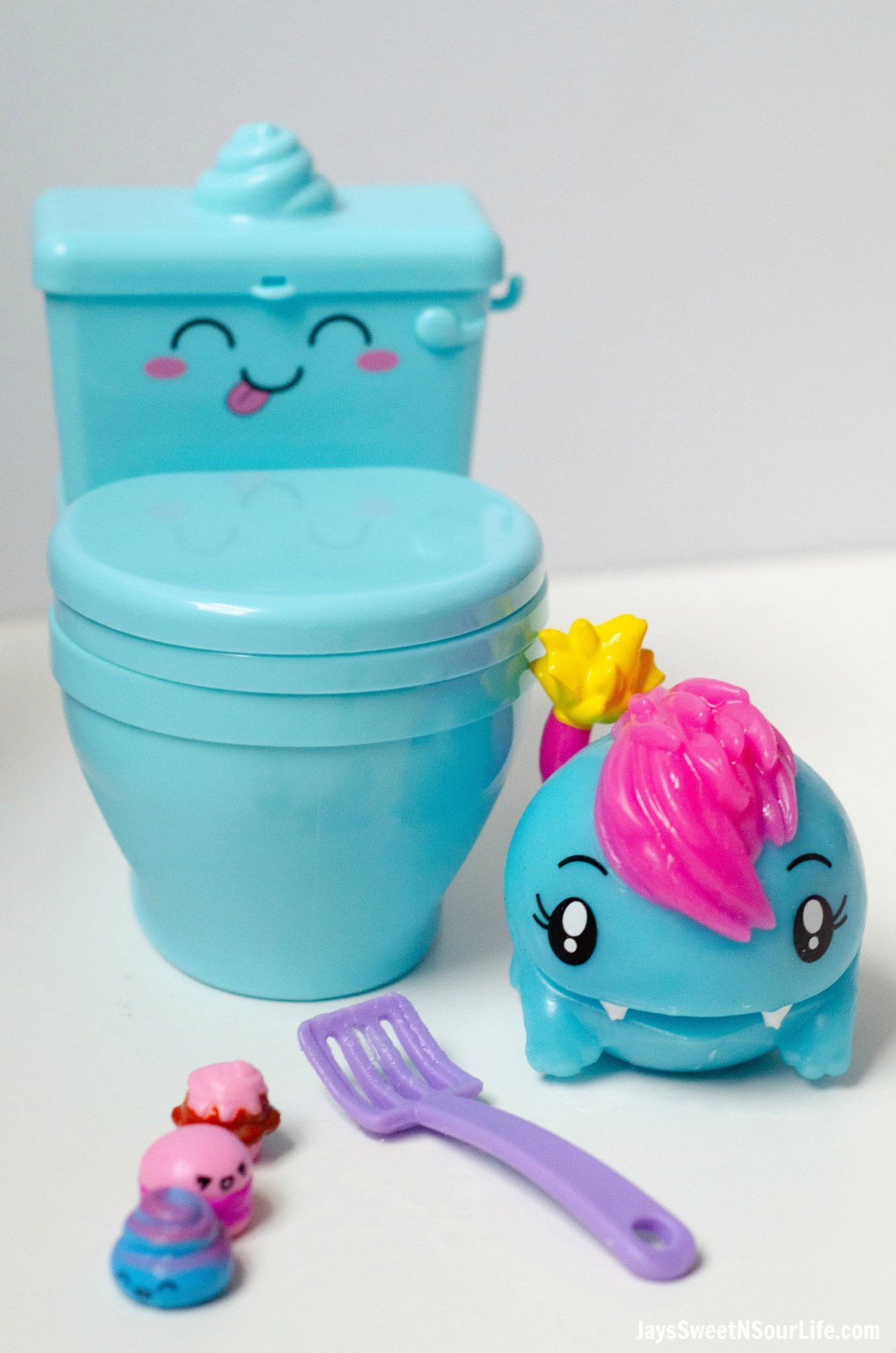 Pooparoos Packaging With Toilet toys and scooper. Pooparoos are full of fun surprises and tons of fun for all.