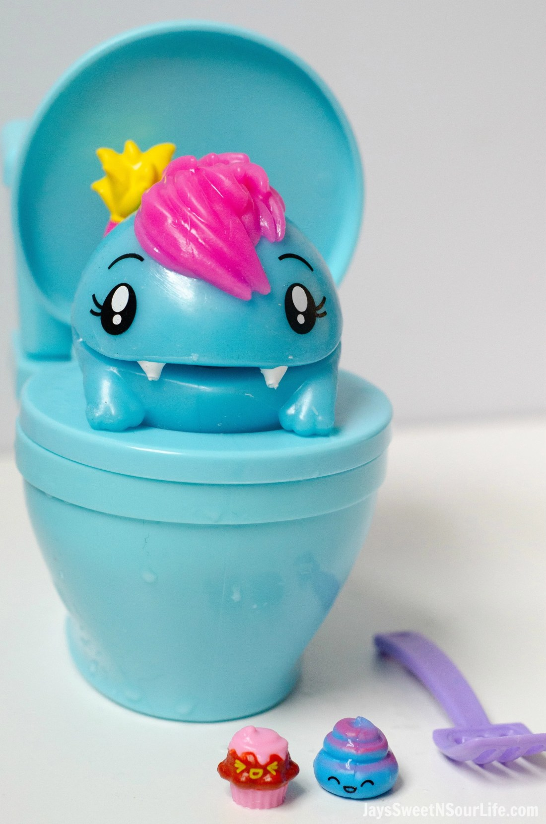 Pooparoos Packaging With toy in Toilet with scooper. Pooparoos are full of fun surprises and tons of fun for all.
