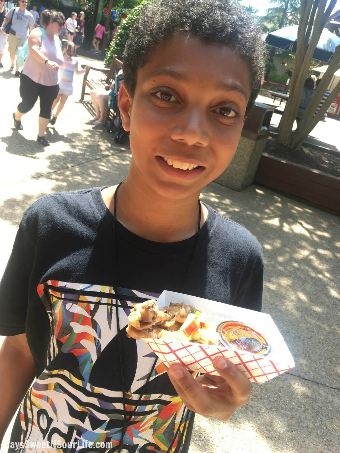 African American boy holding food at 2018 Busch Gardens Food and Wine Festival. Food & Wine Festival is from 11 am to close every Friday, Saturday and Sunday, May 25 - July 1.