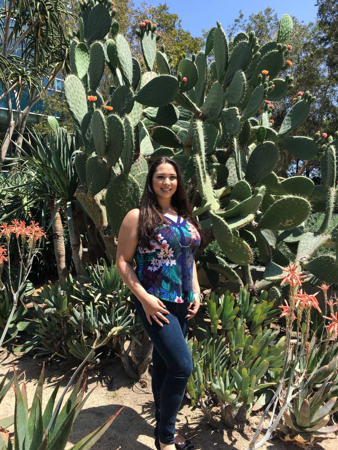 Jessica Simms Jays Sweet N Sour Life at Disney Channel animation Building standing infront of Cactus.