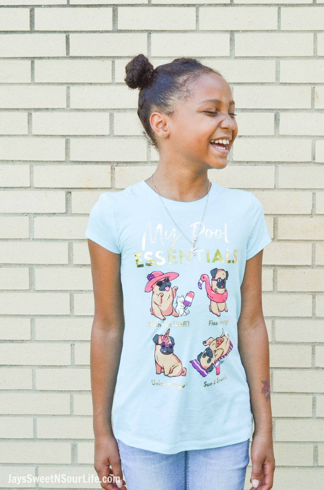 Justice Back To School Shirt Lifestyle Infront of Wall. Back To School Must Have Fashion For Tweens via JaysSweetNSourLife.com
