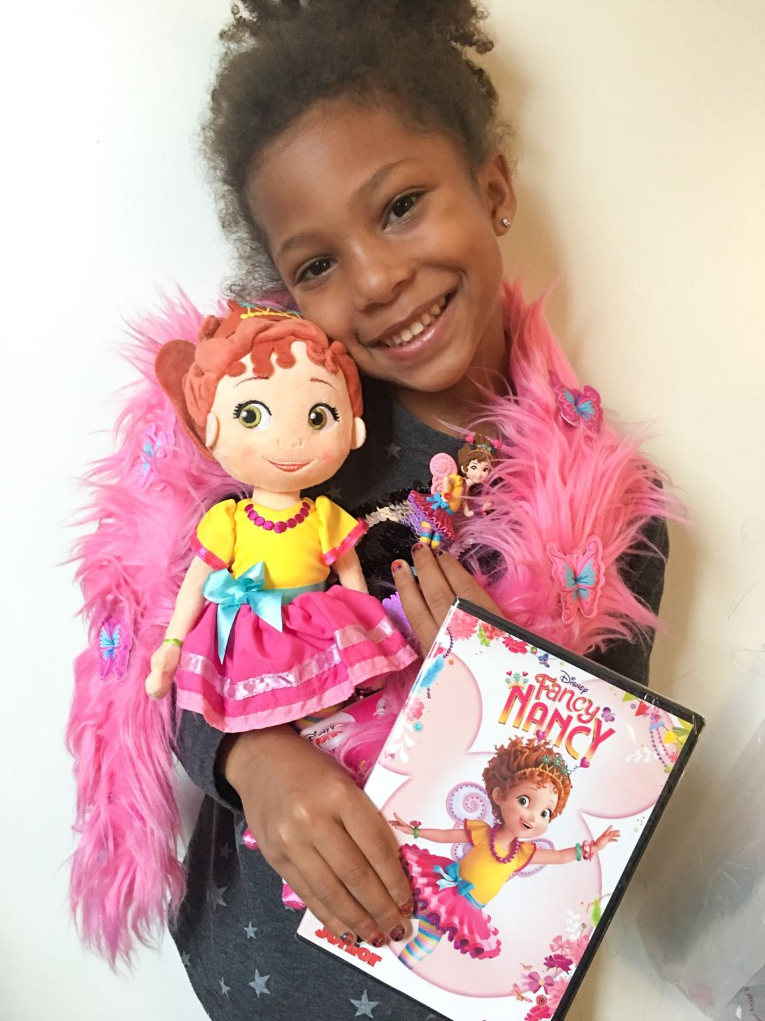 "Esuun Fancy Nancy DVD Doll Figure. Grab some glitter, add a dash of ""ooh la la,"" sprinkle in original songs and Voilà! Get set to pour on the fun with Fancy Nancy in her newest DVD from Disney Junior."
