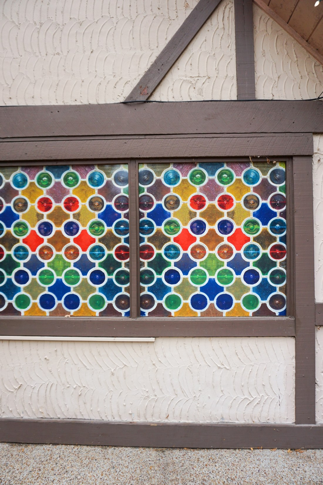 Stain Glass Wall 15 Instagram Worthy Walls Christmas Town Busch Gardens. Instagram Worthy Walls and Locations around Busch Gardens Christmas Town in Williamsburg Virginia.