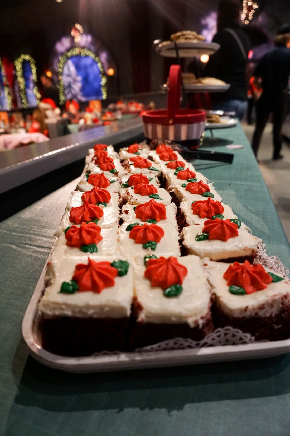 Santas Fireside Feast Red Velvet Cake. Gather around as Santa recounts a classic Christmas story while elves prepare a scrumptious all-you-care-to-eat meal and Mrs. Claus dazzles the dining room with holiday cheer. Read more about this wonderful feast at Busch Gardens Christmas Town in Williamsburg, Virginia.