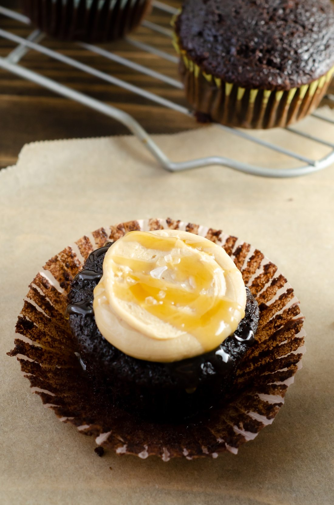 Super Moist Chocolate Cupcakes From Scratch Salted Caramel Frosting Drizilled with caramel and salt. Celebrate any occasion with these decadent Super Moist Chocolate Cupcakes From Scratch with Salted Caramel Frosting and Caramel Filled Center. This homemade recipe is so easy to create, the kids can join in.