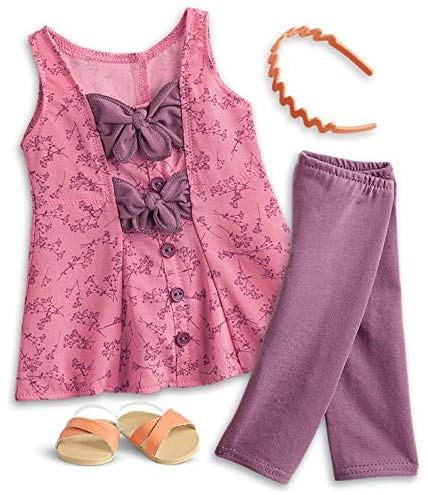 Blaire is always ready for a trip to the local farmers' market or craft store to find inspiration for her projects. Outfit includes: A wildflower-print tunic with plum-colored ties and buttons, Plum-colored leggings to match, A scalloped headband for a pop of color in her red curls, Orange crisscross slide sandals