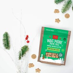 Wag More Bark Less Mini Biscuits Honeybaked Ham. Treat your pup with a holiday Flavor so they know it's the season to wag more and bark less. Geat for both small and large dogs with fun cloud and Star shapes. No grains, corn, wheat, soy, artificial colors or flavors! Include these holiday treats in your dog's stocking as a STUFFER or in a gift bag. This season, give the gift of joy.