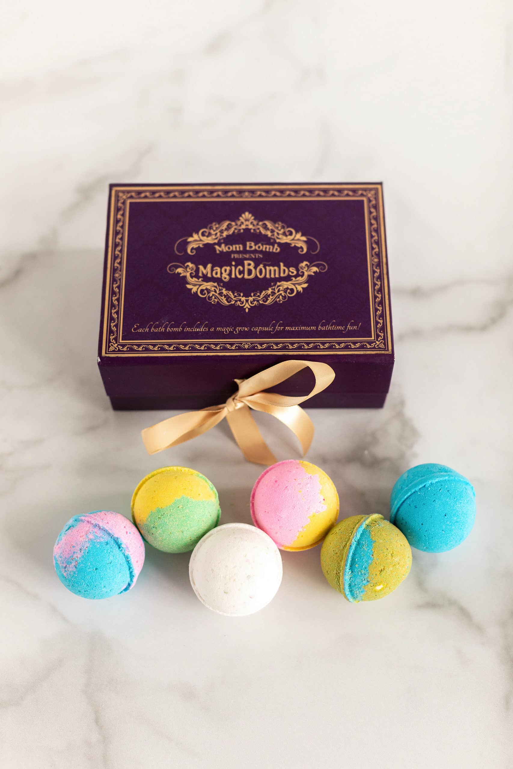 MomBomb Magic Box. Six unique fun-scented, vibrant colored bath bombs are nestled in a beautiful keepsake box, tied with satin ribbon. Each gift set comes with 6 unique scents that are the perfect balance without overwhelming the senses. 2020 Valentine's Day Gift Guide from Jays Sweet N Sour Life Blog.