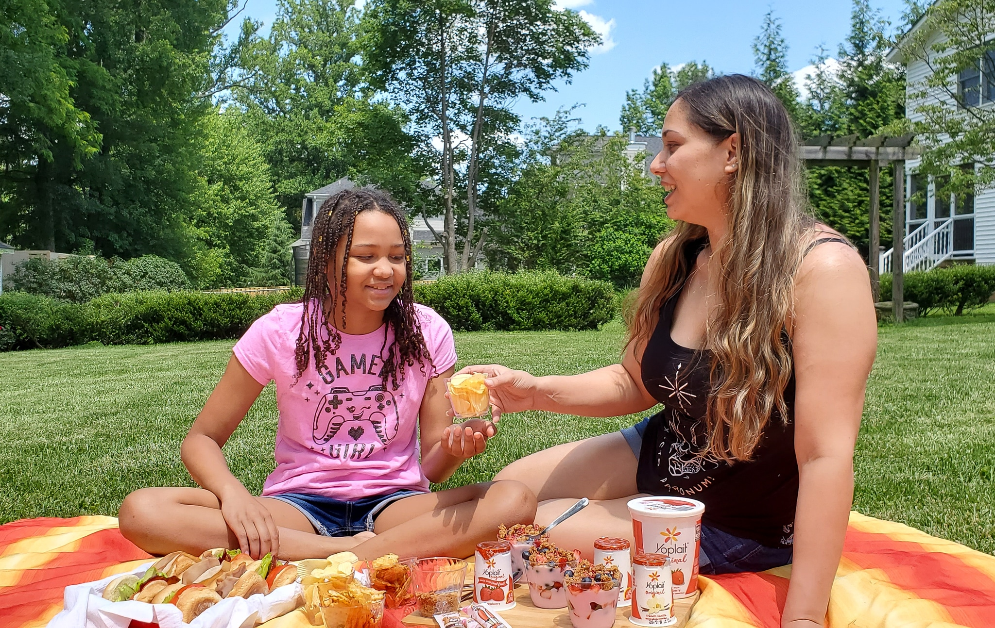Backyard Picnic with Yoplait Mom and Daughter. Grab your picnic baskets! It's time to host your very own backyard picnic featuring the foods your family loves. No need to leave home for this bunch of fun, just pick a date and then prep your picnic baskets.