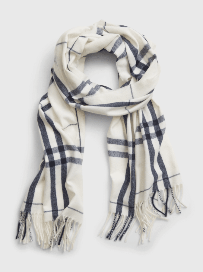GAP Fall Faves Cozy Scarf. The name says it all! This Cozy Scarf offers a soft knit material with a fringe at the edge. Keep warm all fall with this fashionable scarf. Wear it compliment your wardrobe or as a statement piece with a puffy jacket.