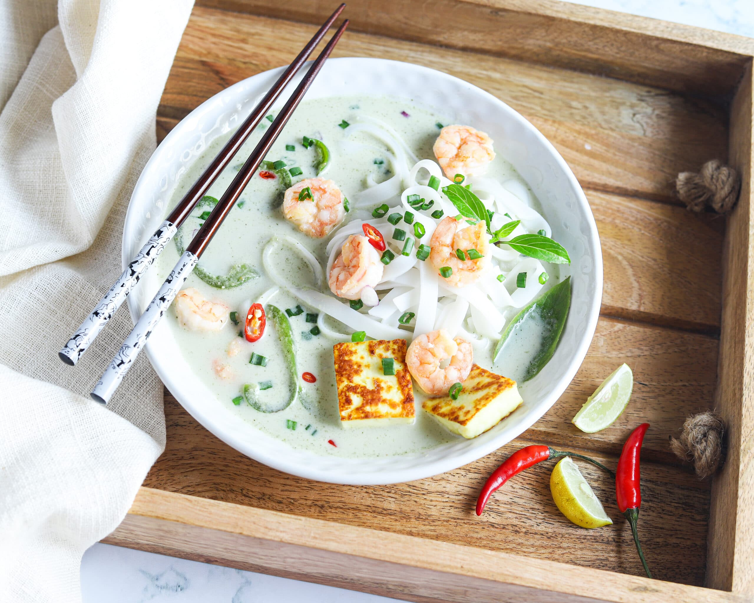 Thai Green Curry Noodles in Tray. These Thai Green Curry Noodles boast a flavorful broth made with coconut milk and fresh ingredients. Fill your bowl with fresh veggies, shrimp, tofu, and rice noodles for a flavorful easy weeknight dinner recipe.