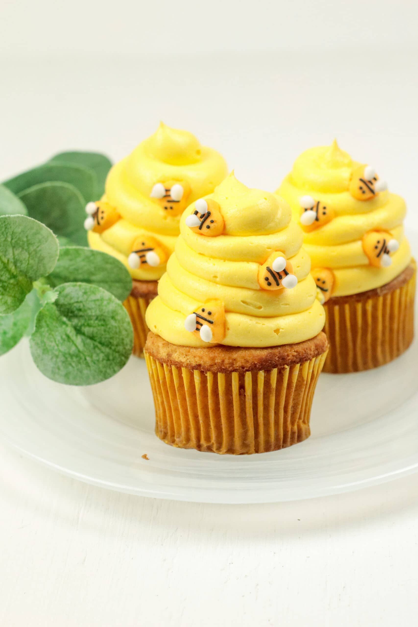 Bumblebee Honey Cupcakes with Honey Cream Cheese Frosting Plated. These Bumblebee Honey Cupcakes with Honey Cream Cheese Frosting are insanely delicious. Made with a touch of honey and cinnamon, these bumblebee inspired cupcakes are almost too cute to eat.