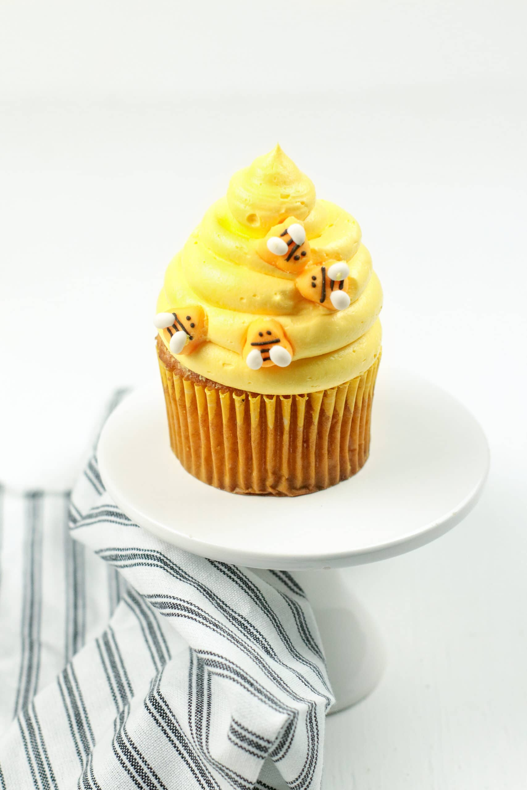 Bumblebee Honey Cupcakes with Honey Cream Cheese Frosting Single. These Bumblebee Honey Cupcakes with Honey Cream Cheese Frosting are insanely delicious. Made with a touch of honey and cinnamon, these bumblebee inspired cupcakes are almost too cute to eat.