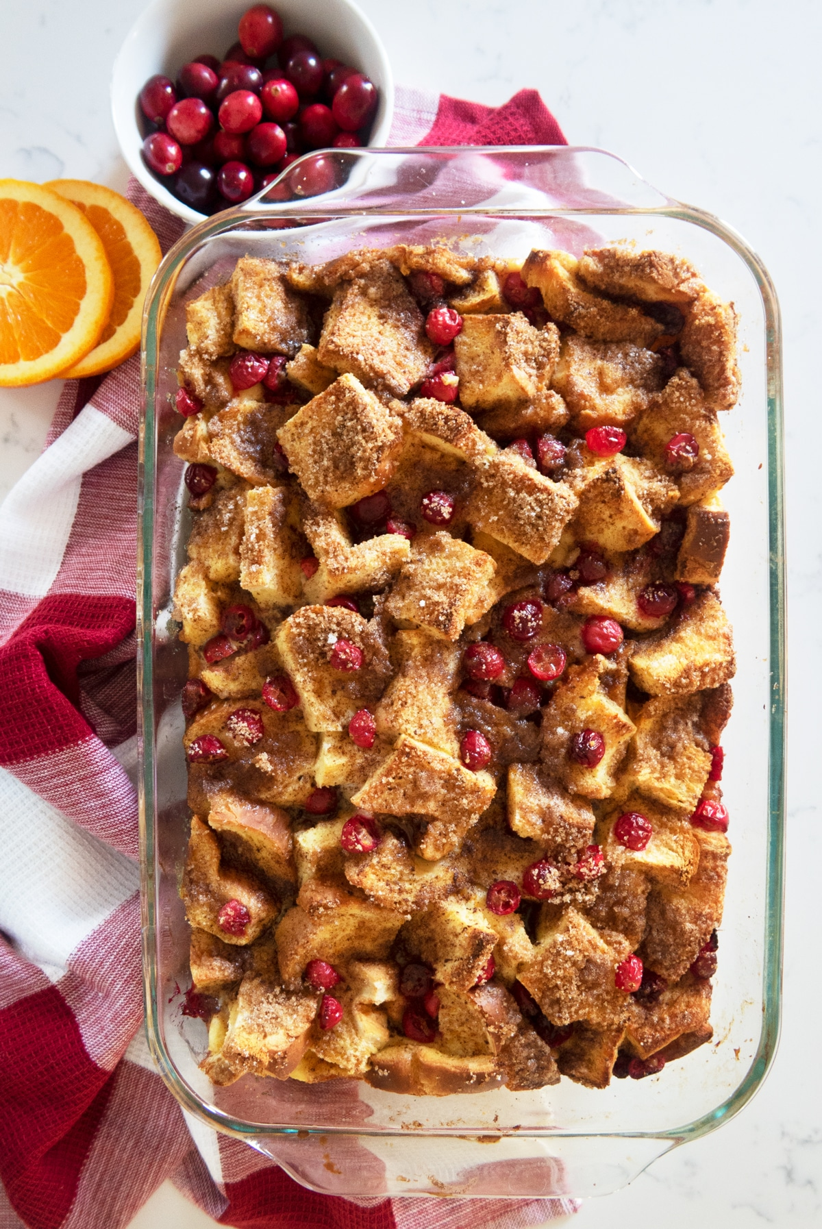 The perfect make-ahead french toast casserole for Christmas morning or brunch. A festive french toast breakfast recipe with cranberries and orange.