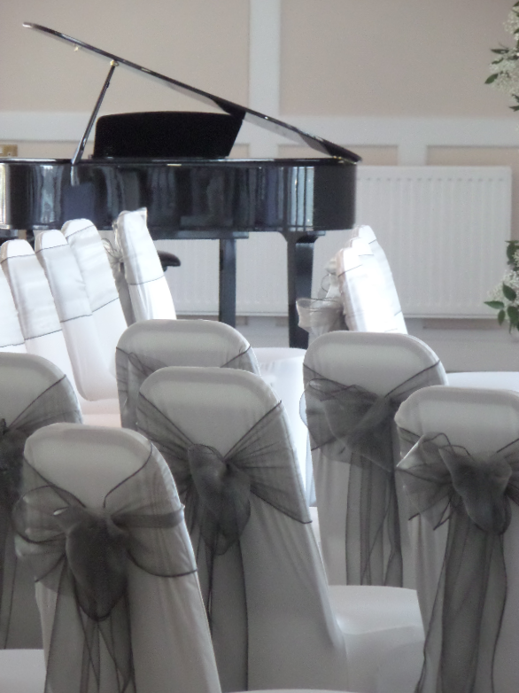 Ceremony Chairs and Baby Grand Piano Shell