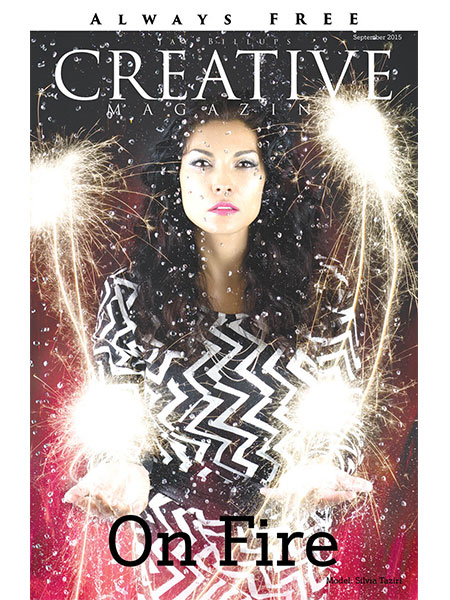 Magazine cover. Pretty Latina woman behind a wall of rain drops and playing with fire, firework sprinklers