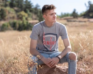Outdoor senior photo session at red rocks canyon open space in Colorado Springs