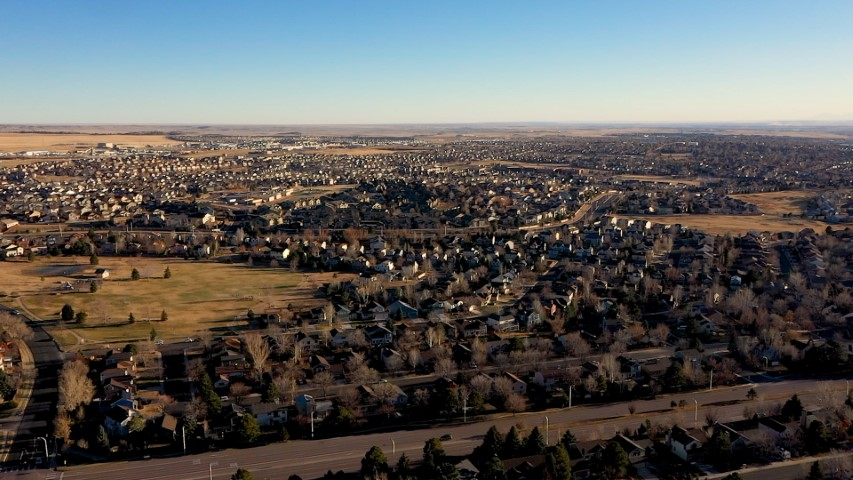 Aerial video of Eastern Colorado Springs neighborhood right before the sun goes down. A sea of houses