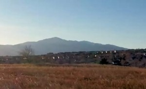 Thumbnail for drone video with Pikes Peak behind a local neighborhood in Colorado Springs