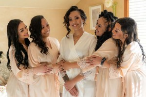 Bride with her bridesmaids in dressing room before wedding