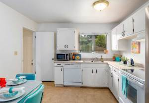 real estate photo of a small kitchen of a home in Colorado Springs