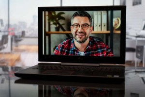 Host of virtual meeting on a laptop computer - virtual portrait for marketing