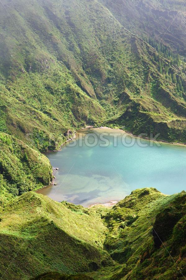 Blue lake mountain slope - Jan Brons Stock Images