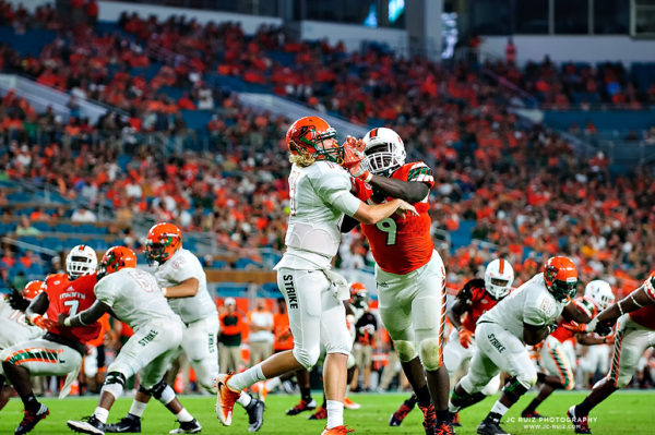 Hurricanes DL, Chad Thomas, delivers a blow to the helmet of FAMU QB, Ryan Stanley