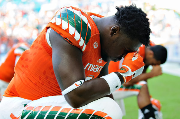 Chad Thomas says a prayer before the start of the game