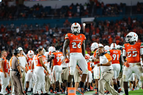 Hurricanes DB, Rayshawn Jenkins, celebrates after his interception