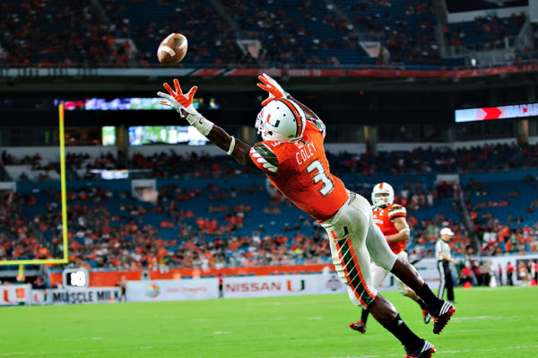 Hurricanes WR, Stacy Coley, leaps to try to catch the pass