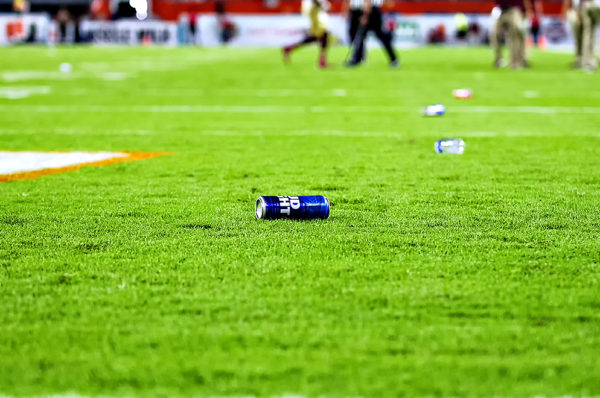 Bottles and beer cans line the field after Miami Hurricanes fans threw them in protest to a whistle by the officials