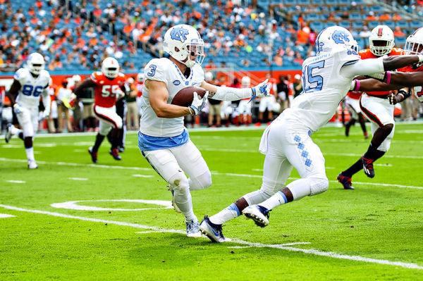 Tar Heels WR, Ryan Switzer, follows his blocker after a catch