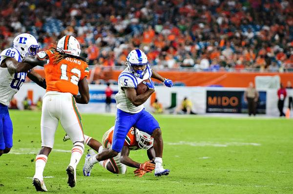 Johnathan Lloyd, Duke WR, breaks away from a tackler