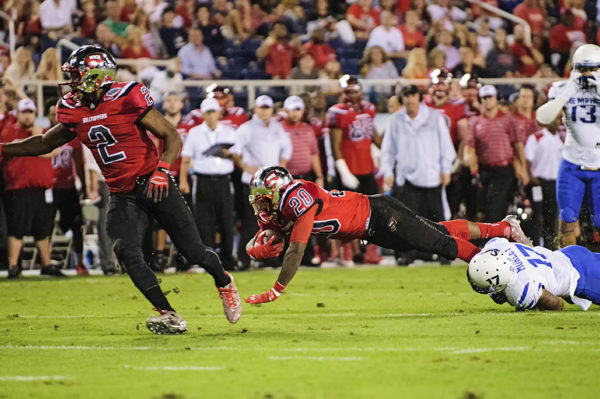 WKU RB, Anthony Wales, tries to dive past a defender