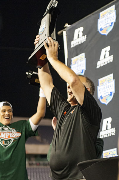 Mark Richt hoists up the championship trophy for all to see