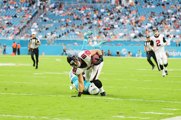 Falcons TE, #81 Austin Hooper, tries to escape from the tackle of Dolphins S #20, Reshad Jones