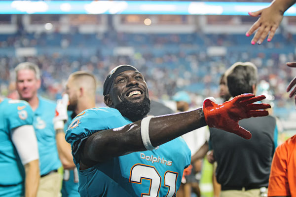 Dolphins S #31, Michael Thomas, gives high fives to fans