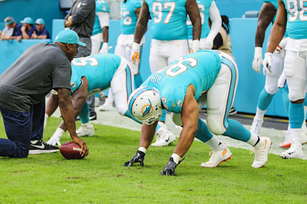 Dolphins DL, #93 Ndamukong Suh, practices his technique prior to the game