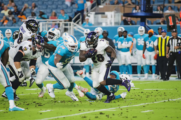 Terrance West, Ravens RB #28, looks to rush for a lane to rush the ball through