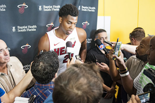 Heat center, Hassan Whiteside, gives an interview surrounded by media