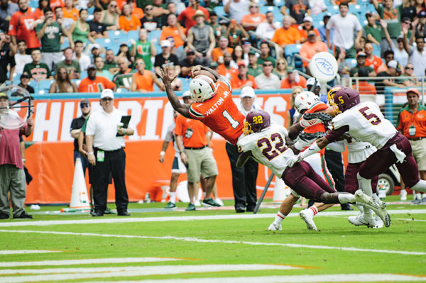 Mark Walton leaps for a touchdown