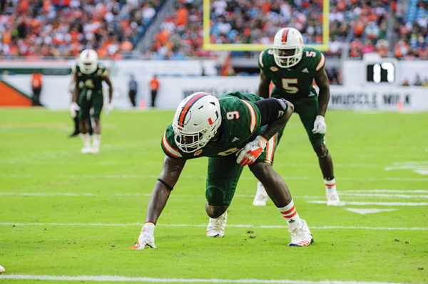 Hurricanes defensive end Chad Thomas (9)