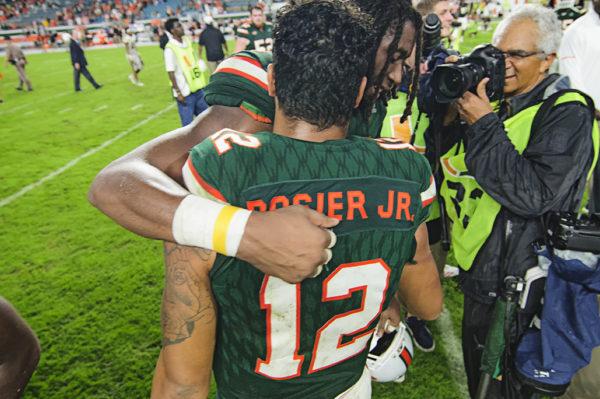 Malik Rosier and Darrell Langham hug after the game