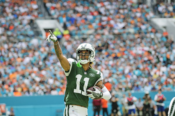 Robby Anderson (11) points to the crowd after his touchdown