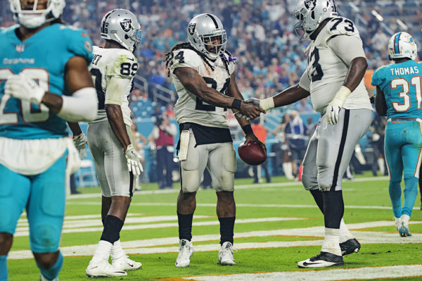 Marshawn Lynch (24) shook the hands of all his teammates after his touchdown