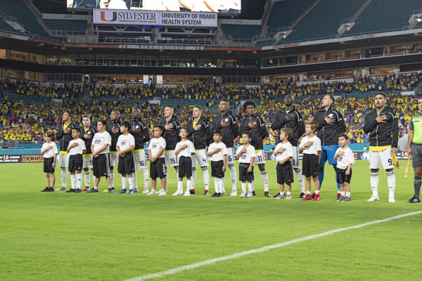 Colombia players singing their national anthem