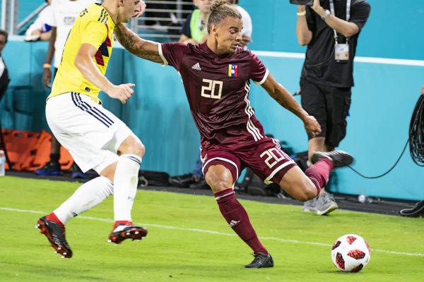 Rolf Feltscher strikes the ball