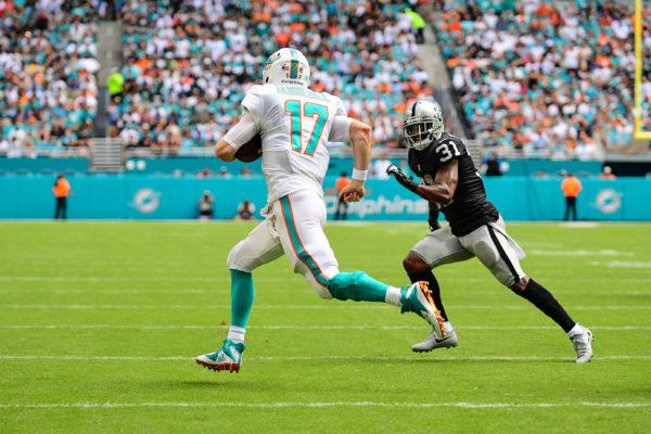 Miami Dolphins quarterback Ryan Tannehill (17) scrambles for a first down