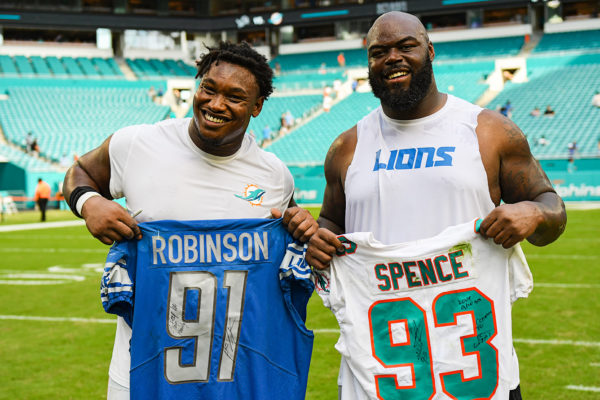 Detroit Lions defensive tackle A'Shawn Robinson (91) and Miami Dolphins defensive tackle Akeem Spence (93) exchange jerseys